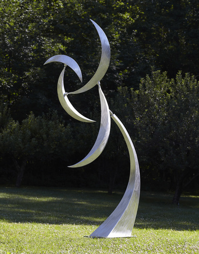 Jeff Kahn Kinetic Sculpture. Large scale outdoor sculpture created from aluminum and stainless steel and powered by wind.